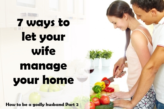 Portrait of pretty female cooking salad with her husband near by